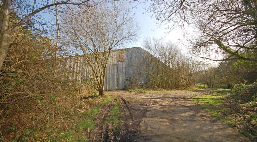 Pentre coed - outbuilding and track.jpg